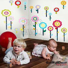 Not quite it, but close.  PEEL and STICK Kids Nursery Removable Vinyl Wall Sticker Mural Decal Art - Rainbow Flowers Lollipop