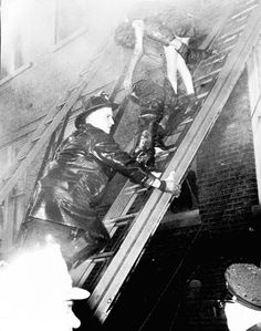 Lady of Angel's Fire  ~Firemen rescue girl, 1958  ( Tribune archive photo )  Firemen rescue an injured girl from the Lady of Angels school's second floor, after a fire sent twelve hundred students scrambling for their lives. Three nuns and 87 children died the day of the fire and in the following months five more children died from wounds.