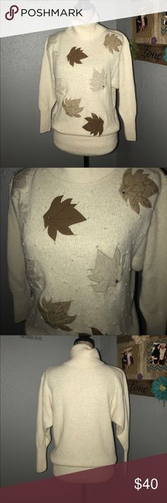 Cream turtleneck w/leaves appliqué and pearl beads EUC, no marks or stains, very minor fuzzies. Perfect for fall and winter, so pretty and delicate, pictures don't do this sweater justice!!  Laying flat, measurements are bust 19 inches, shoulder to hem 27 inches.  I could see this being so cute with dark skinny jeans and brown boots 😊 Jarrod's Sweaters Cowl & Turtlenecks