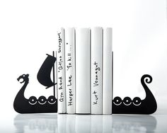 """The design is based on the images of traditional boats used by vikings, people living many hundred years ago in Northern Europe.   Laser cut for precision, strong enough to hold a bunch of favorite books.   One piece measures approximately 6 in height and 3""""54 in width (visible part) , 4""""3 deep. (heigth 17,5, width 11,5 depth 9 cm)  Sold by a pair only."""