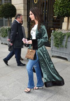Green with envy: Passersby were no doubt astounded by Emily's famous beauty...