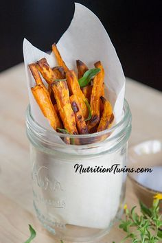 """Roasted Tarragon Garlic Sweet Potato """"Fries""""   Only 92 Calories   Sweet & Savory   Fiber & Nutrient Packed  Fight inflammation  For Nutrition & Fitness Tips, and RECIPES please SIGN UP for our FREE NEWSLETTER www.NutritionTwins.com"""