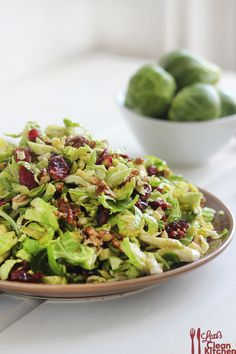 Brussels Sprout Slaw with Cranberries and Crumbled Candied Pecans {and Honey Dijon Cinnamon Vinaigrette}