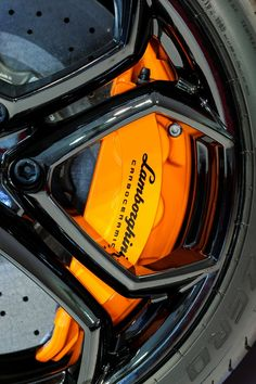 Brembo brake calipers hugging carbon ceramic brakes.