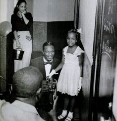 7 year old Gladys Knight, meets her idol Mr. Nat King Cole! 1957 (via Powerful black Stories)