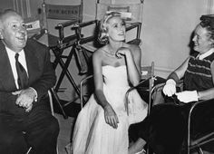 Grace Kelly (centre) on the set of 'To Catch a Thief' with director Alfred Hitchcock) and his wife Alma Reville (1955)