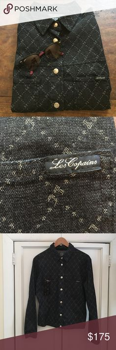 Beautiful Les Copains light denim jacket A Les Copains light denim jacket designed and manufactured in Italy. This jacket features two front pockets and is a dark denim with silver metallic thread woven through in a beautiful intricate diamond pattern. Stunning condition, size 42 Italian which fits like a US 4-6 according to their website. Great year round piece as a light summer jacket or during the winter as a top with the sleeves cuffed. This is a must have piece! Les Copains Jackets…