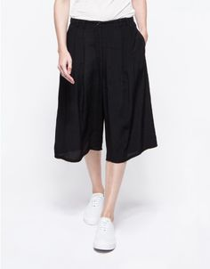 Modern culottes with a loose, relaxed fit and front pleating. Features a front zip fly and button closure and belt loops.   	•	Pleated culottes with front pleating 	•	Relaxed fit 	•	Front zip fly and button closure 	•	100% rayon 	•	Hand wash cold