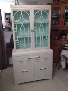 Vintage china cabinet, 1930's, painted with antique white chalk paint, distressed and sealed. Mint green interior. Original hardware. Solid wood, American made. Sturdy, clean, functional, charming!...