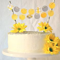 Baby Shower Cake With Paper Banner and Fresh Flowers