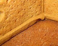 Tint half of your Royal Icing the same shade of brown as your gingerbread dough and use that icing to assemble the house (Gingerbread House)