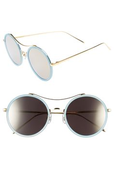 These pastel blue rounded sunglasses are undeniably retro-chic.