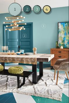 Blues and greens are a foolproof combo because they neighbor each other on the color wheel. Using pale aqua as the dominant color in this dining space makes it easy to layer in bolder colors, such as the deep teal on the door and trim, plus the bright green incorporated in the floor. Lime accents pick up the gold tones in the room. Behr 1. Polished Aqua (walls) 2. Wanderlust (doors and trim) 3. Jade Dragon (accent) 4. That's My Lime (accent)