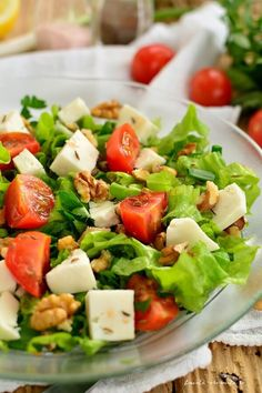 Photo about Mediterranean salad with lettuce, feta cheese, tomatoes and nuts. Image of menu, diet, dinner - 95919753 Romanian Food, Lettuce, Cobb Salad, Feta, Salad Recipes, Food And Drink, Meals, Dinner, Cooking