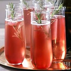Give your favorite sparkling drink a holiday twist by adding cranberry and rosemary. The additions add a delicious flavor and play up a traditional holiday color scheme. Party Drinks, Fun Drinks, Yummy Drinks, Alcoholic Drinks, Winter Cocktails, Christmas Cocktails, Holiday Cocktails, Craft Cocktails, Sparkling Drinks