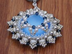 Elsa Pendant Tutorial As I was finishing up this pendant, I took a look at it and couldnt help but think of Elsa from Frozen with the beautiful