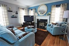 how aarange the livingroom with a fire place and tv stand  | ... Living Rooms With Blue Sofa And Armchair Also With Wooden TV Stand At