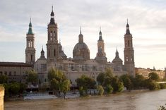 Basilica of Our Lady of the Pillar, Zaragoza, Aragon, Spain  The first recorded Marian apparition occurred while the Blessed Virgin Mary was still on earth. While praying by the banks of the Ebro at Saragossa, the Holy Mother of God bilocated and appeared to the Apostle. She instructed him to build a church there, which he did.