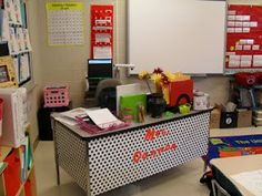 Wrap your desk in wrapping paper! So much cuter. Fabric would be even better to hold up better.