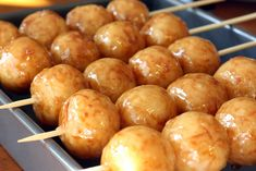 Karioka (Filipino Deep-Fried Coconut Rice Balls with Brown Sugar Glaze). alternate here: http://voices.yahoo.com/carioca-filipino-dessert-favorite-7239102.html?cat=22 or here: http://angsarap.net/2011/10/25/karioka/
