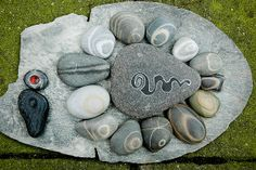 "Jos van Wunnki/flickr: ""grey stones    Stones from de Normandy coast. I painted the big one and the black one down left. The other are all natural !"""