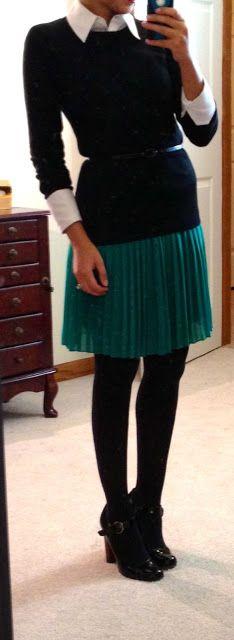 accordion skirt, sweater, button-up, belt.