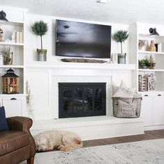 This room is asymmetrical. Neither TV nor fireplace are in the middle.This room is asymmetrical. Neither TV nor fireplace are in the middle.(no title) Hottest Totally Free Electric Fireplace Ideas Suggestions Everyone Loves A Fire Built In Around Fireplace, Fireplace Tv Wall, Family Room Fireplace, Fireplace Built Ins, White Fireplace, Fireplace Remodel, Fireplace Design, Fireplaces With Tv Above, Fireplace Bookshelves
