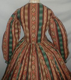 "Documented 1860's Cotton print Dress | eBay fiddybee worn by Maria Catherine Blauvelt Ramsey (1823-1902, Ramsey, NJ estate; piping at neck, bust, armscyes & waist, bodice lined with cotton, bodice lining has front hook & eye closure, skirt unlined except wide band of cotton at hem; light underarm discoloration mostly to lining, 5"" period mend on edge of skirt back, front waist enlarged (materinity?); bust: 32""; waist: 30""; skirt length: 41""; hem width: 132"""
