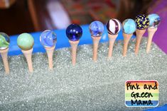 "KZ: this inspires me to make ""gazing globes for fairy houses"" I would stain the tees a darker color or spray metallic. hot glue the marbles on and poke them around the garden. Original link: Pink and Green Mama: Preschool At Home: Marbles and Golf Tee Gamehttp://pinkandgreenmama.blogspot.com/2009/11/preschool-at-home-marbles-and-golf-tee.html"