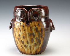 OMG!  An owl yarn bowl!  How cool!  I NEED this for my knitting room! A little pricey though. :(