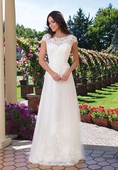 Sincerity Bridal Style A classic wedding dress look created by a Sabrina neckline, natural waistline, and chapel length train. Beaded and corded lace completes this demure wedding day look. Sincerity Bridal Wedding Dresses, Lace Wedding Dress, Modest Wedding Dresses, Wedding Dress Styles, Bridal Dresses, Wedding Gowns, Bridal Lace, Dresses Uk, Prom Dresses