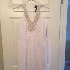 Laundry cocktail formal dress. White size 0. NWT. NWT. Beautiful Laundry cocktail or evening dress. White with rhinestone detail at neckline. Size 0. New with tags. Purchased from Nordstroms. Laundry by Shelli Segal Dresses Midi