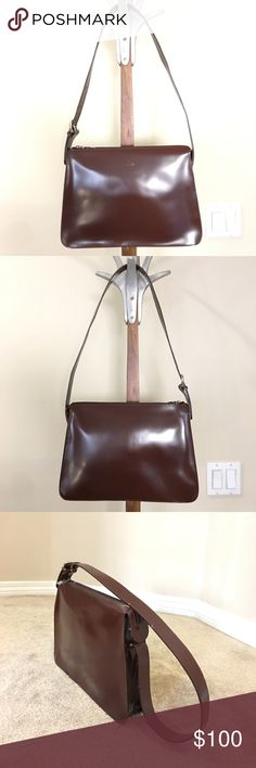 FURLA structured leather purse, made in Italy FURLA structured leather purse in brownish-burgundy color.  Made in Italy. Purchased but never worn, though has very subtle scratches on leather exterior.  Structured handle is bent just a bit, but doesn't affect wear. Adjustable length shoulder strap. Please ask questions prior to purchase. 🚫trades, reasonable offers only. Furla Bags Shoulder Bags