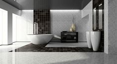 Spacious no-expense-spared black and white bathroom with stand-alone sinks and large white tub
