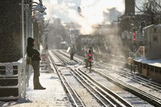Waiting for an L Train in the freezing winter.. something i DO NOT MISS AT ALL!  Frozen Chicago: What The Windy City Looks Like Under Ice, Thanks To The Polar Vortex (PHOTOS)