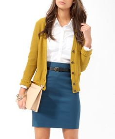 Cute and simple peacock pencil skirt, mustard cardigan, white blouse.  Good work outfit.