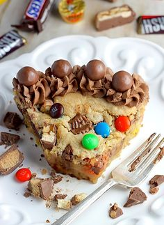 Halloween Candy Cookie Cake - Soft, chewy, and loaded with candy! YUM.