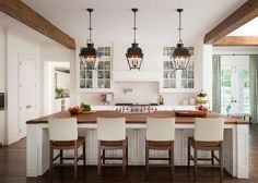 This comfortable Colonial home stays mostly traditional but with some contemporary and country styling added here and there. The great room features a high ceiling with wood beams, and shiplap walls are found throughout the space. The eat-in kitchen has lantern pendants over a large island. A patriotic theme can be found in some areas.