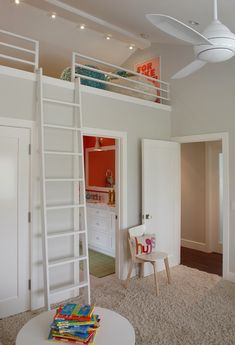 source: K Mathiesen Brown Design Fun, contemporary girls' play room with loft space over bathroom filled with white bean bags and For Like Ever Print.
