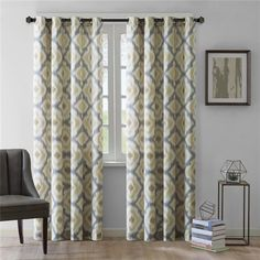 """Update your windows with a refreshing touch of color and pattern. This cotton printed window panel features a beautiful multi ikat print in muted tones of yellow and grey to liven up any room. The 100% cotton fabric provides easy care and texture for an updated natural look. Grommet top detail makes it easier to hang, open, and close panels throughout the day. Fits up to 1.25"""" diameter rod."""