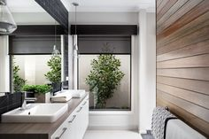 Dark coloured pelmet with translucent roller blind.                                                                                                                                                     Window Furnishing: Roller Blinds                                                                                                                                                     Room: Bathroom, Laundry & WC