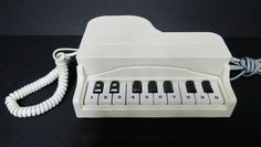 Piano Telephone... @Christine Doknjas , didn't you have one like this?  In black?!?