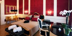 Schloss Schönbrunn Suite: The walls are decorated with hot pink damask wallpaper.
