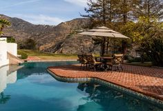 This Malibu pool has gorgeous mountain views and plenty of sunshine.