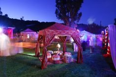 We could do this out near the fire too if we wanted, just get a gazebo frame (which I have) and string the coloured fabric/tarps over it ?