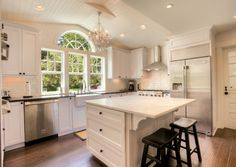 High End White Kitchen Remodel by Powell Homes & Renovations