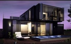 black container home with two floors