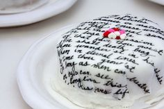Rice paper! How to: write on it with food coloring, then stick it to the cake.