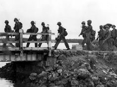 Leathernecks of the First Provisional Marine Brigade on Guam as they head for the scene of battle. Agat beachhead - August 5, 1944. (National Archives 80-G-239317).