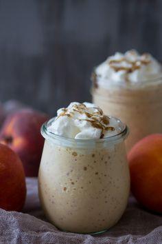 This vanilla peach bourbon milkshake is the perfect boozy summertime frozen treat. Vanilla bean paste mixed with fresh peaches, bourbon and vanilla bean ice cream. It's the perfect cocktail + dessert!